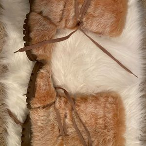 Rabbit fur boots. Bought in Spain